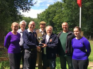 Robin Hackshall presents the Triscombe Challenge Cup to Adrian Pamment, The Colchester Club Captain, together with part of the Colchester Team